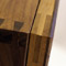 Hand cut dovetail joints in walnut wallcupboard